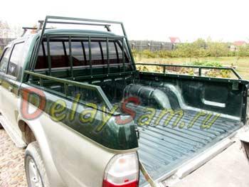 Защитная рама - багажник в кузов Mitsubishi L200. Рейлинги и багажник для Мицубиси Л200